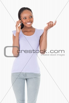 Close up of woman talking on the phone on white background