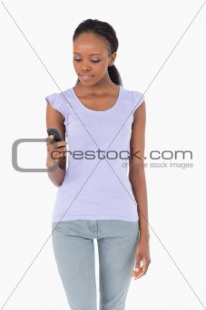 Close up of woman texting on white background