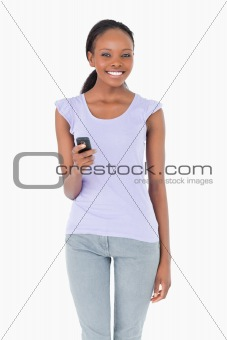 Close up of woman writing a text message on white background