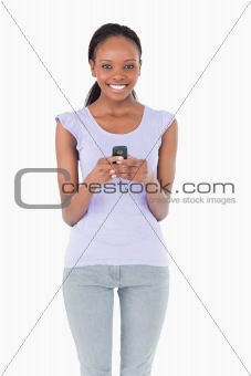 Close up of woman holding cellphone on white background