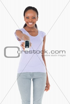 Close up of woman presenting her phone on white background