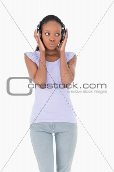 Close up of woman listening to music on white background
