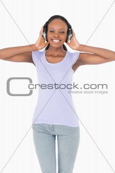 Close up of woman enjoying music on white background