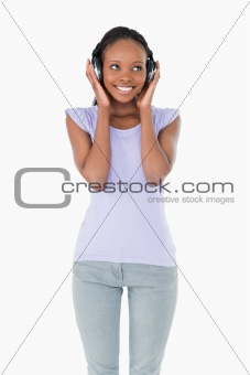 Close up of happy woman listening to music on white background