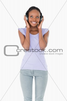 Close up of happy woman enjoying music on white background