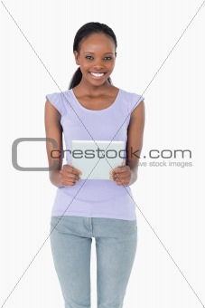 Close up of woman holding tablet on white background