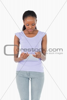 Close up of woman looking at tablet on white background