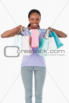 Close up of woman with her shopping on white background