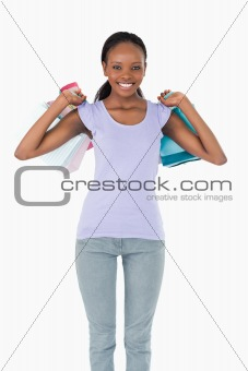 Close up of woman with shopping on white background