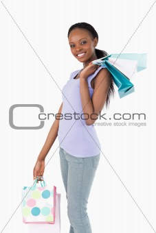 Close up of happy woman with her shopping on white background