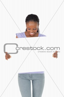 Close up of woman looking at placeholder in her hands on white background