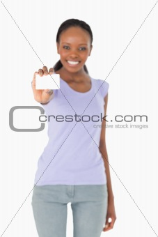 Business card being presented by woman on white background