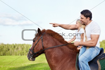 Father and daughter on a horse