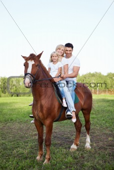 A family on a horse