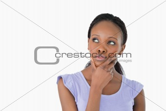 Close up of woman thinking about something on a white background