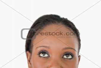 Close up of woman's forehead on white background