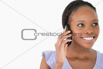 Close up of woman on the phone on white background
