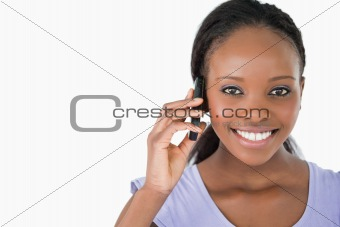 Close up of young woman on the phone on white background