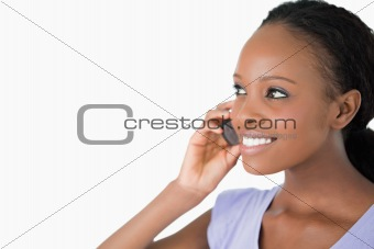 Close up of woman talking on her phone on white background