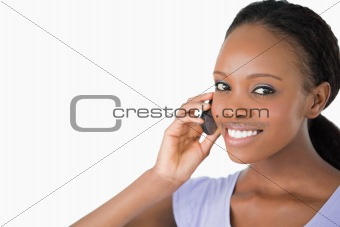 Close up of woman on the phone against a white background