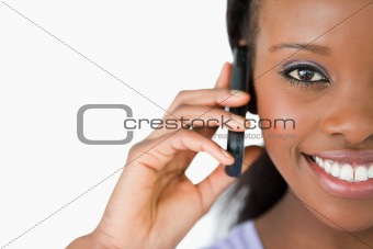 Close up of woman on her phone against a white background