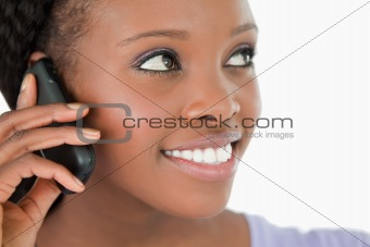 Close up of woman listening to caller on white background