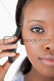 Close up of woman on the mobile phone on white background