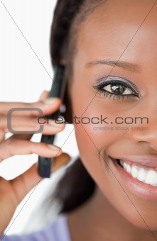 Close up of woman using her phone on white background