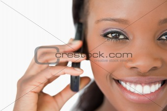 Close up of woman using mobile phone on white background