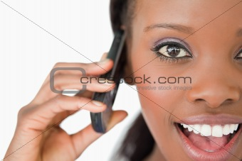 Close up of surprised woman on the phone on white background