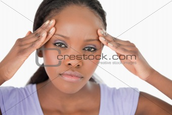 Close up of woman with headache on white background