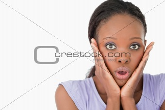 Close up of frightened woman on white background
