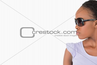 Close up of woman with sunglasses on white background