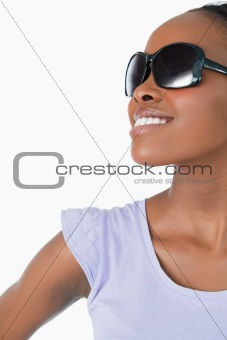 Close up of woman wearing sunglasses on white background