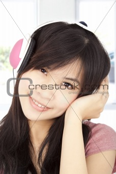 smiling asian young girl listening to music