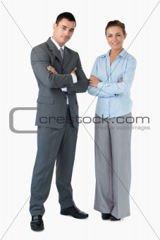 Business partner with arms folded against a white background