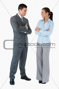 Business partner looking at each other against a white background