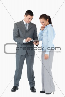 Business partner analyzing documents against a white background