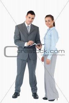 Business team with clipboard against a white background