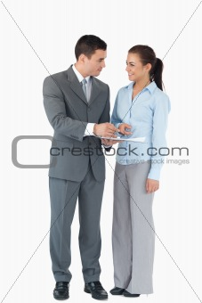 Business partner analyzing data against a white background