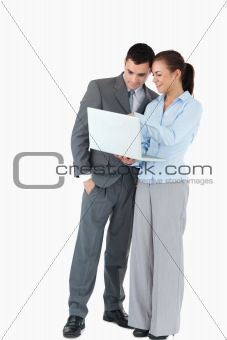 Business partner looking at a laptop against a white background