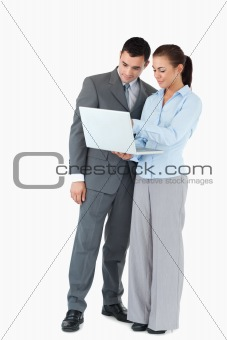 Business partner looking at a notebook against a white background