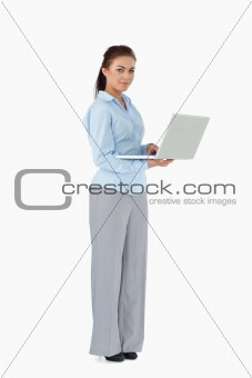 Businesswoman with her laptop against a white background