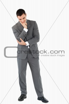 Businessman looking on the floor while thinking