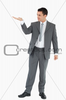Businessman looking at what he is presenting