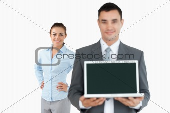 Business partner presenting laptop