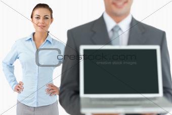 Business team presenting laptop