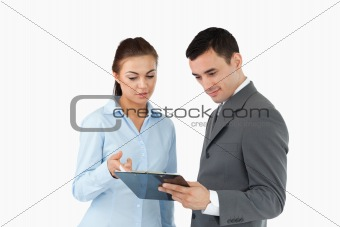 Business partners taking a look at the clipboard