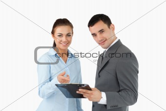 Smiling business partners with clipboard