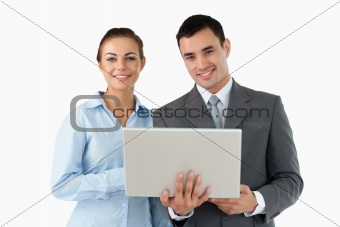 Smiling business partners with laptop